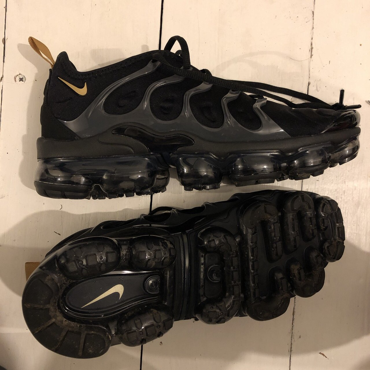 black vapormax with gold tick