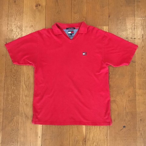 502401ae @donmajorsstreetwear. 9 months ago. Bristol, United Kingdom. Tommy Hilfiger  Red V neck polo tee. Embroidered flag logo ...