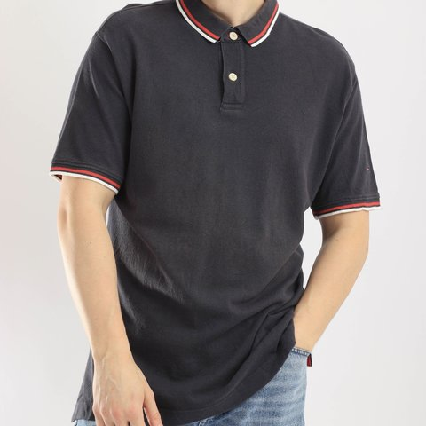 d7b59597 @vintequila. 14 days ago. South Croydon, United Kingdom. Tommy Hilfiger  vintage polo shirt in navy. Embroidered logo.
