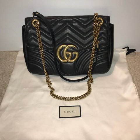 d995b473e761 @almaortakand. last year. London, UK. GUCCI GG Marmont medium matelassé  shoulder bag. Black leather.