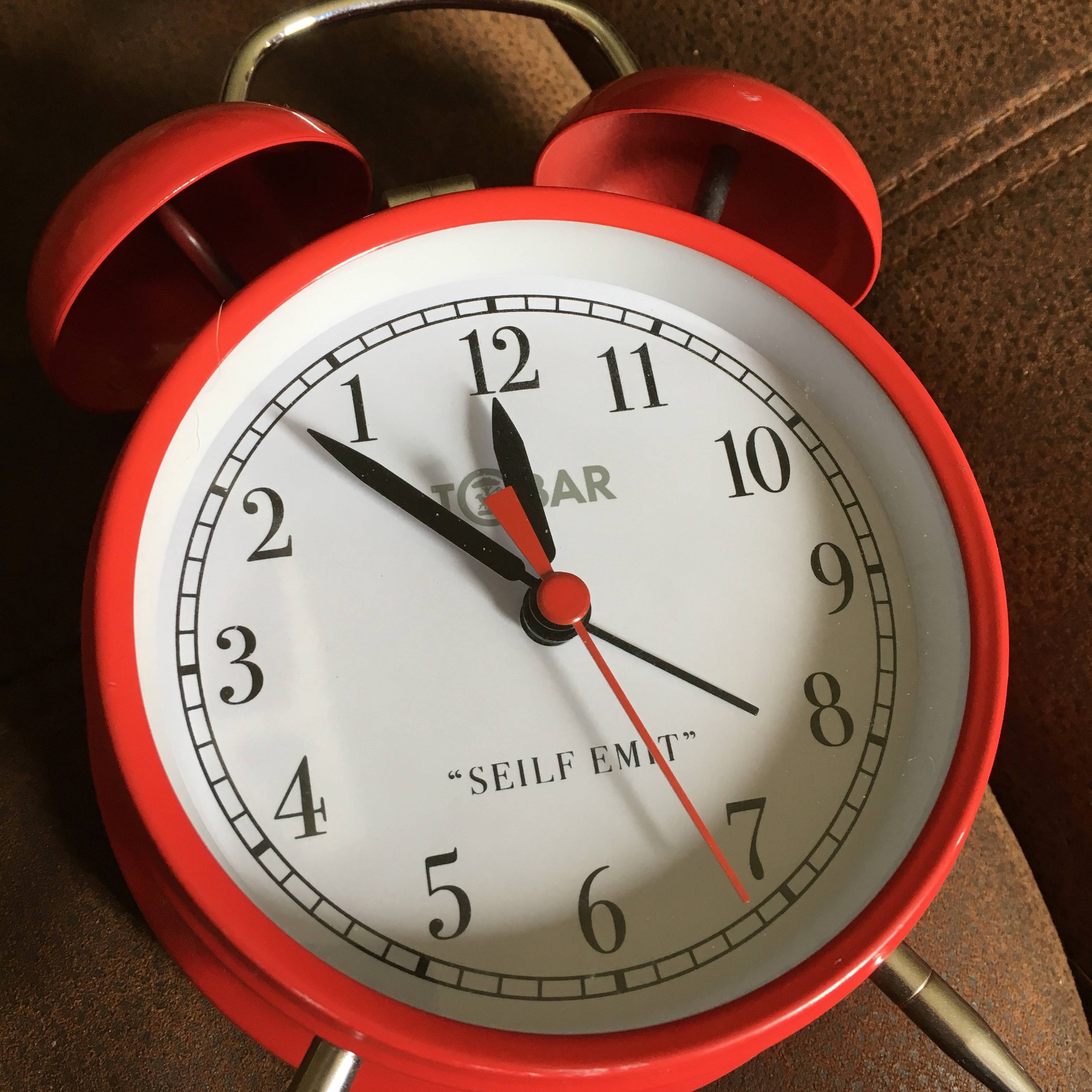Awesome red traditional alarm clock, works backwards