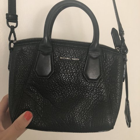c05ac39948de @lilintrovert. 9 months ago. Martinez, United States. All-black small  Michael Kors crossbody bag.