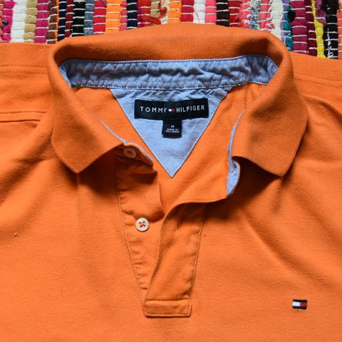 e370c7e7 @pwalker621. 2 years ago. Canterbury, UK. Orange Tommy Hilfiger Polo shirt