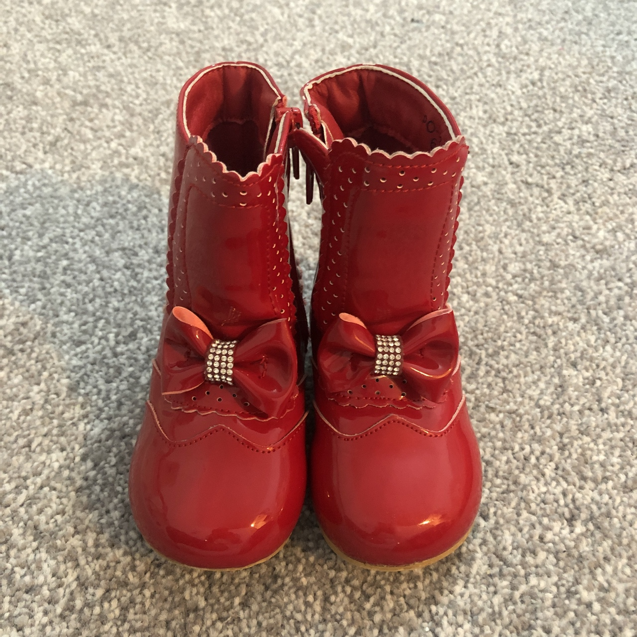 Girls red boots with diamanté bows