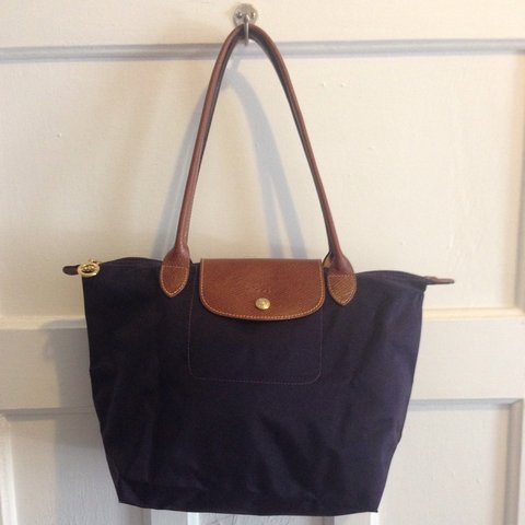 535aa9aad8 @emilymira. 3 years ago. Montreal, QC, Canada. Authentic Longchamp Le  Pliage small tote ...