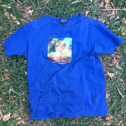 f35b7296d whacky 2000s blue t-shirt with holographic baby patch. super - Depop