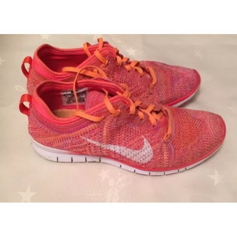 online store 79931 22f2e  bethanyabbott. last year. London, United Kingdom. Women s Nike free TR  flyknit in pink orange ...