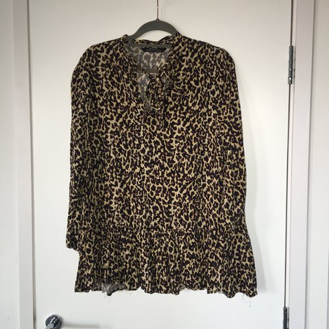 86165c1ad9f4 @rgibson. 11 months ago. Manchester, United Kingdom. Zara animal print  blouse with bow