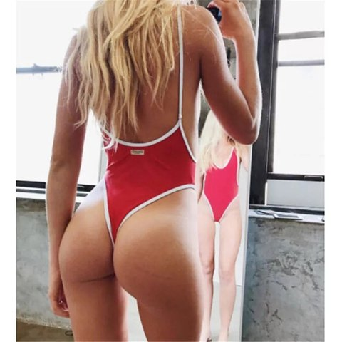 d6553b6eb8c @boutiquelingerie. 5 months ago. Chessington, GB. Sexy red Brazilian style  open back swimsuit. Makes your bum ...