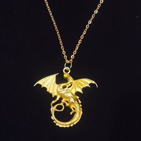 The golden dragon necklace earrings also available on the depop aloadofball Choice Image