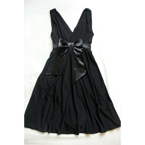 bec48f630446 Slinky black plunge dress with a silky bow detail at the is - Depop