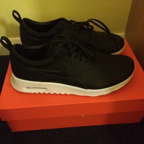 49c309a114 @kavey. 3 years ago. London, UK. RESERVED. Nike Air Max Thea Black Leather  Premium Trainers ...