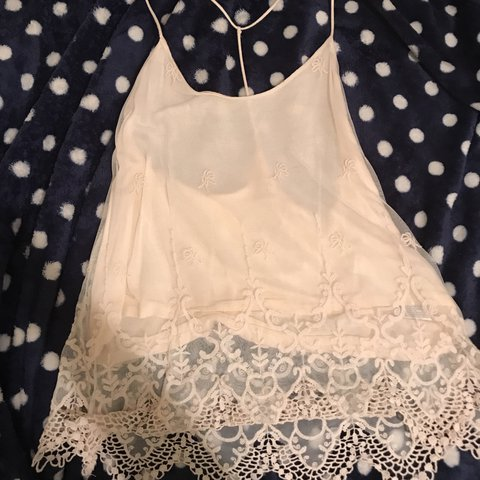 f1a620dcf4 The most precious tank with a lace overlay. It does run a at - Depop
