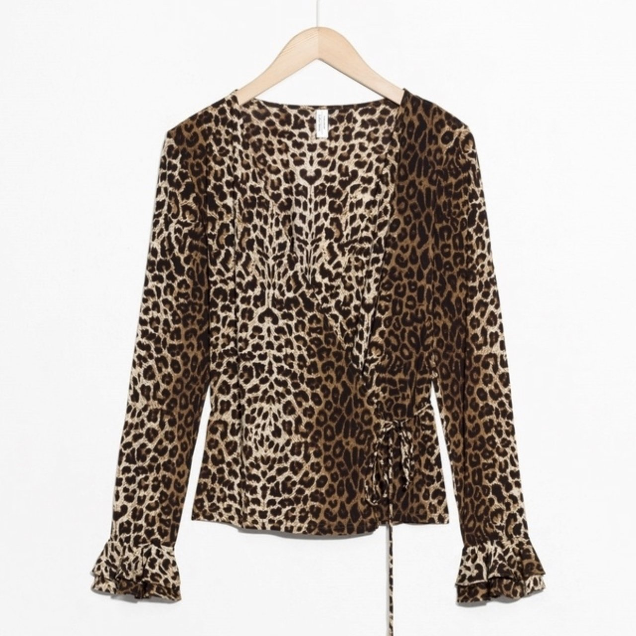 82e20e115bed @georgiescott01. 3 days ago. United Kingdom. & Other Stories leopard print  wrap blouse ...