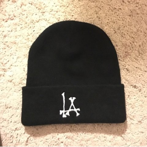 9e2f5fac8f8 Brandy Melville LA bones beanie. Worn a few times but still - Depop