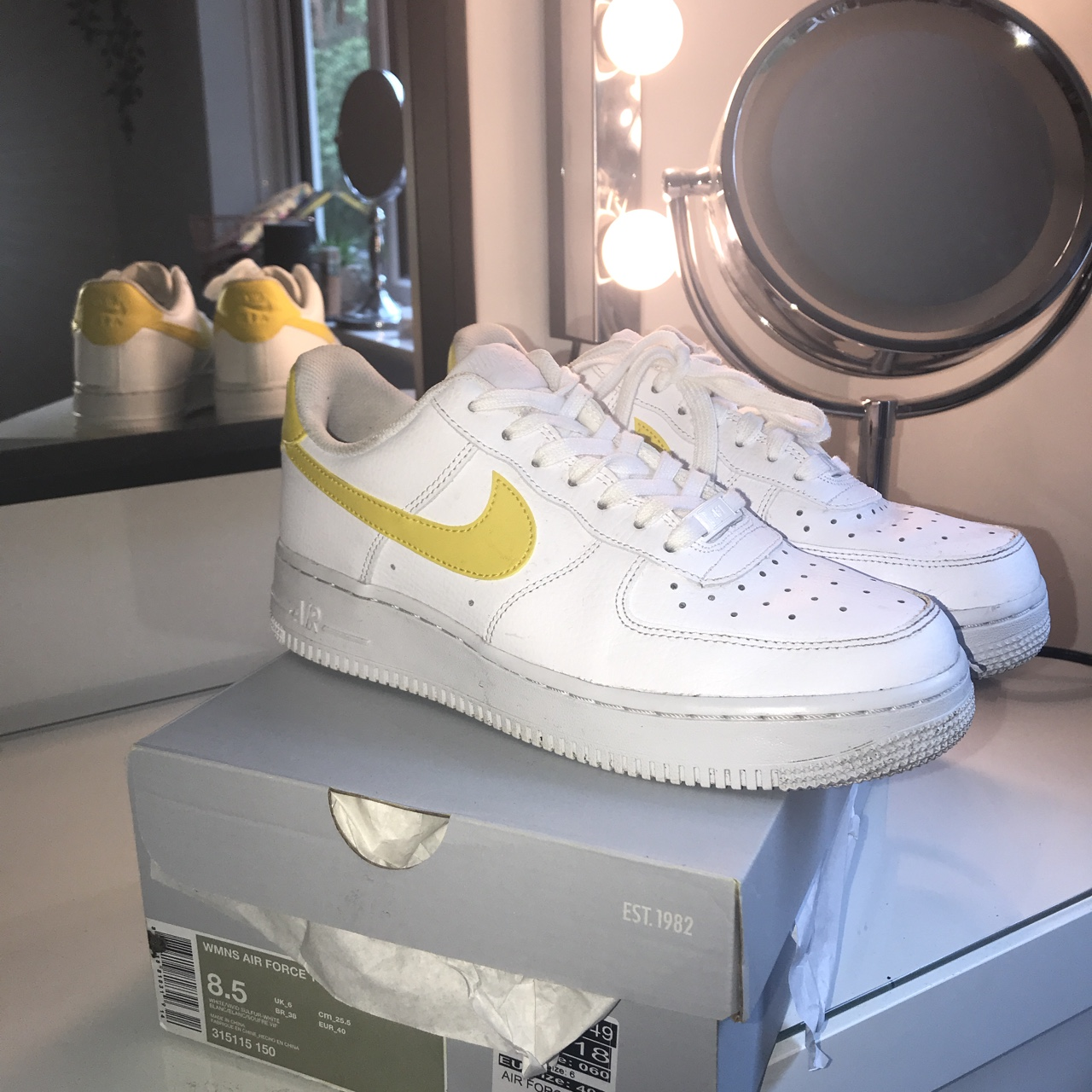 Nike white Air Force 1 with yellow tick