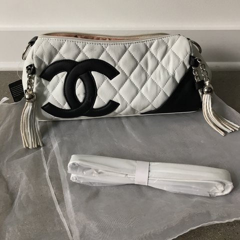 f2b0f8dcbd3fe7 @raymill123. last year. Fairfax, United States. Vintage Chanel bag. White  and black leather, logo ...
