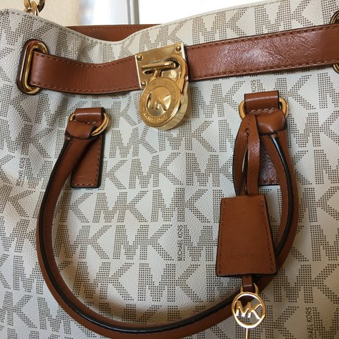 d11735b2b079 @liddleowl. 3 years ago. Henderson, United States. Michael Kors Large  Hamilton- Vanilla MK logo with Lock ...
