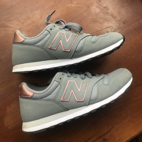 62f12374581cb Nike New balance 373 trainers, grey and rose gold/pink, wear - Depop