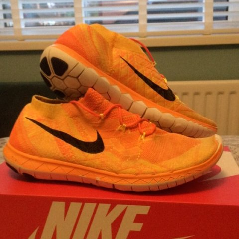 9db78097fe17 NIKE FREE RUN ORANGE SIZE 9 GREAT CONDITION WILL COME - Depop