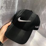 24c91396fe8 Red Nike Swoosh Hat with black rim and NIKE print on the - Depop