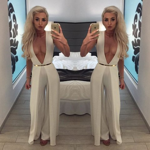 78563408eb41 White low cut  V  jumpsuit cullote trouser effect. Really a - Depop