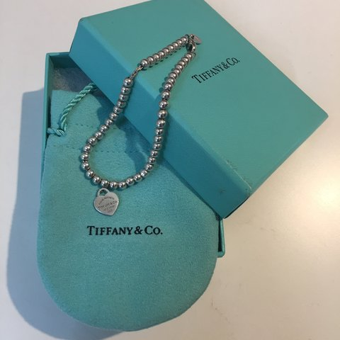 7a8c445d2 @roxanne123. 4 months ago. Shepton Mallet, United Kingdom. Return to Tiffany  bead bracelet. Sterling silver tag with Tiffany Blue enamel finish