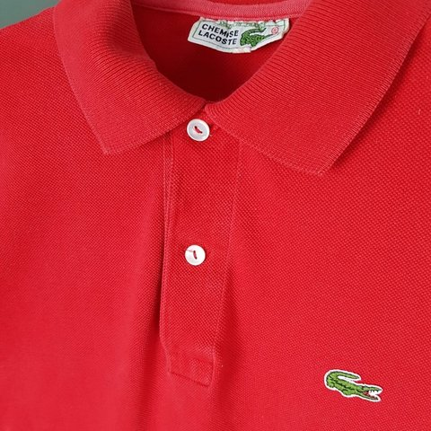 011286ac @flyvintage_. 3 months ago. Solihull, United Kingdom. Red Chemise Lacoste  Short Sleeve Polo Shirt In good condition 2 button fastening. Made in France  ...