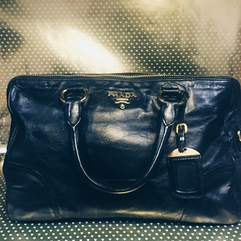 e3f6df4cd4c887 Prada leather handbag with shoulder strap and fab gold Good - Depop