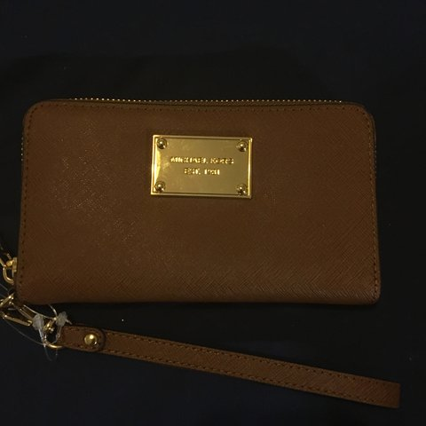 7798c65c60a28a Michael Kors peanut wristlet. Bought in the MK flagship in 6 - Depop