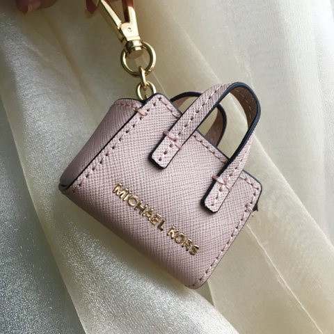 0c7d5baf0762 @agirlnamedalisa. last year. Lowell, United States. Dusty Rose Michael Kors  Handbag accessory/keychain.