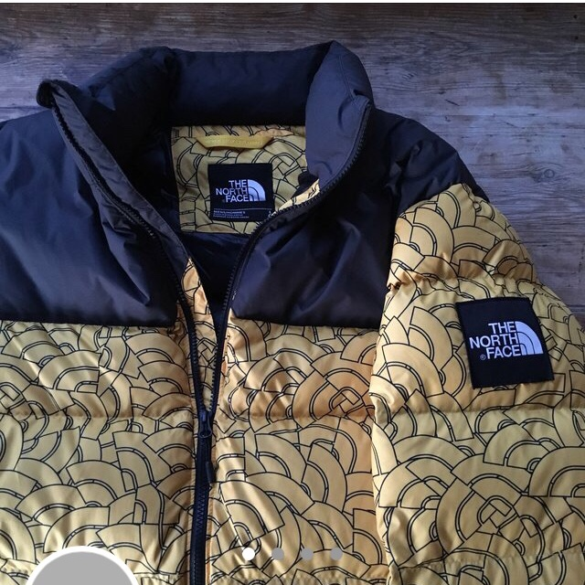 03e137142 The North Face macaroni all over logo print yellow... - Depop