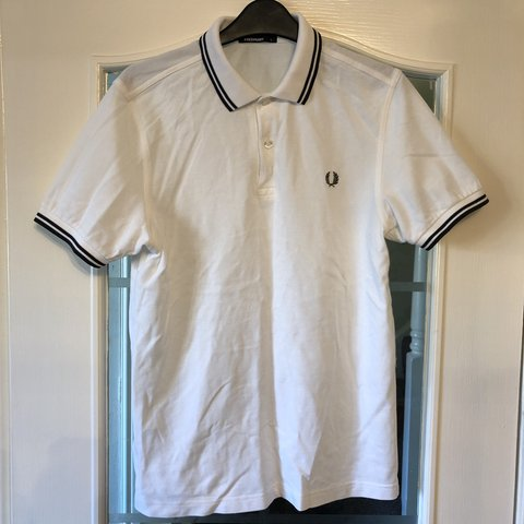 9ec3f1e3 @tomtrainer97. 3 months ago. Stockton-on-Tees, United Kingdom. Men's white  and dark grey Fred Perry twin tipped polo shirt size small.