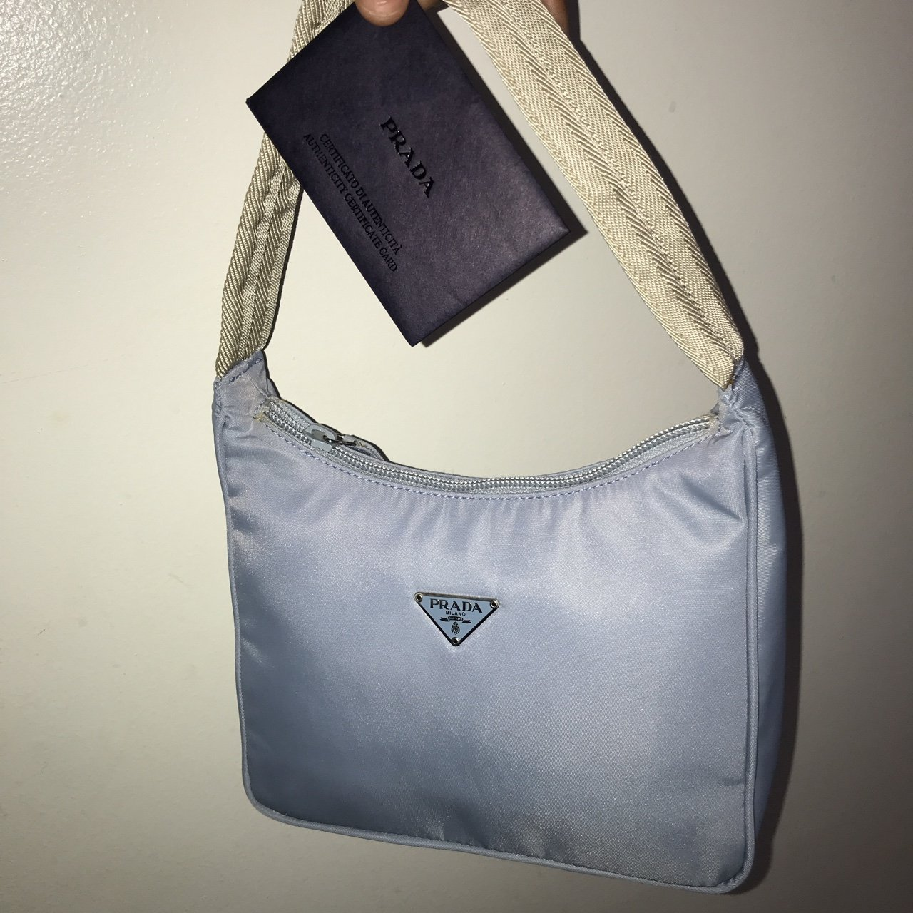 503838af2ea @leftoversfromparadise. last year. New York, United States. The cutest  little Vintage BabY blue nylon Prada bag ...