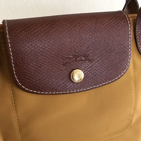 2c967c7f683 Longchamp Women's Le Pliage Medium Handbag. Mustard. Used a - Depop