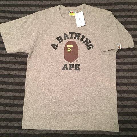 8e6cc43e ITEM DESCRIPTION: A Bathing Ape Bape College Tee (purchased - Depop