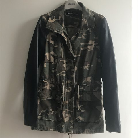 406414d3a9201 @ogechi360. 2 years ago. London, United Kingdom. Camouflage print jacket  with faux leather sleeves.