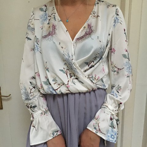 76115792205 @maggedpeach. 2 years ago. Londyn, Wielka Brytania. BERSHKA 💐beautiful  satin long slevee white floral wrap top. NEW without tags never been worn  ...