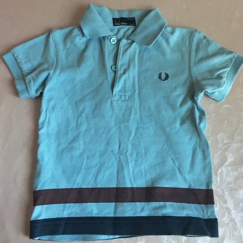 0b256b84 @dalhussain. 2 years ago. Cardiff, UK. Fred Berry kids blue polo shirt size  ...