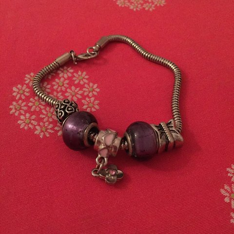 e7a703ff9 @heyitzzzzme. 3 years ago. Canada. Fake pandora bracelet with two purple  charms , one butterfly charm ...