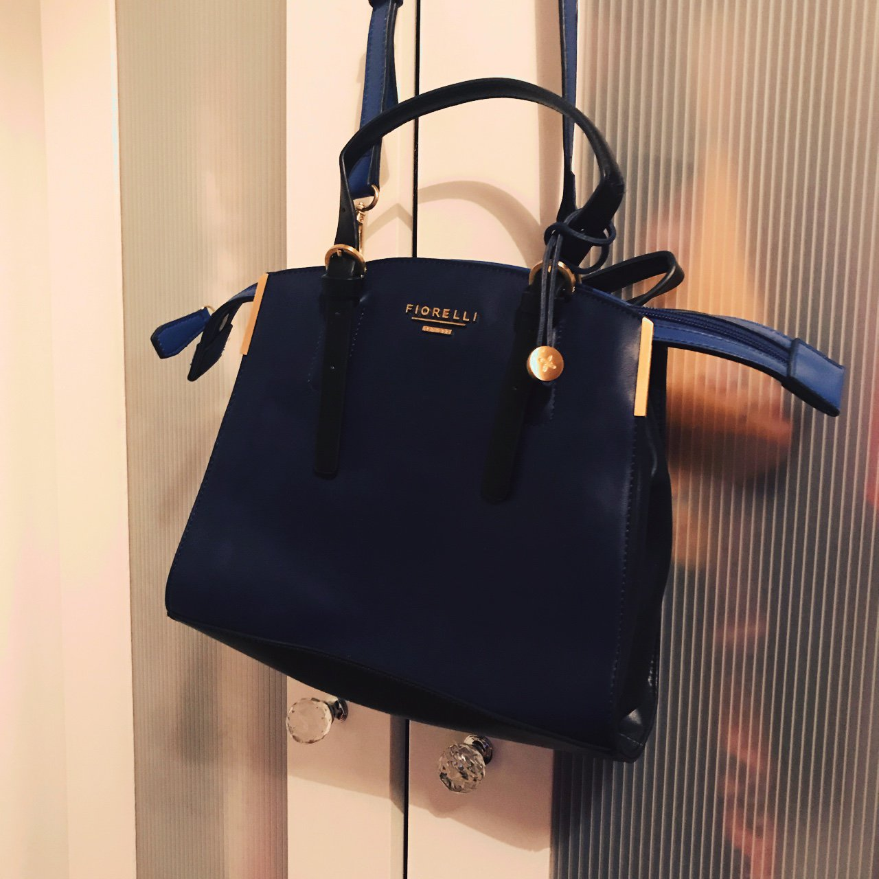 7c27284fb284 Fiorelli navy small bag with black strap. Worn once - in new - Depop