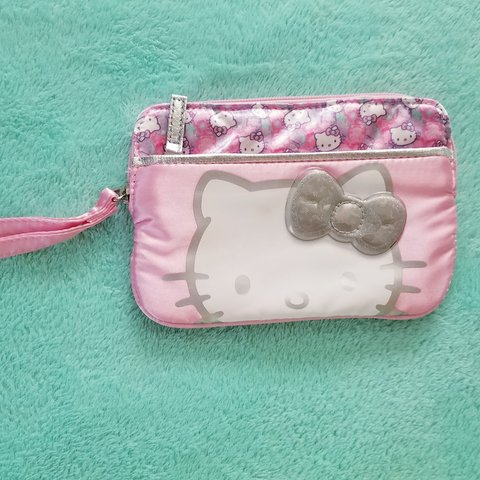 3c34c5d5e NEW* Hello Kitty wristlet with a front zippered Material is - Depop