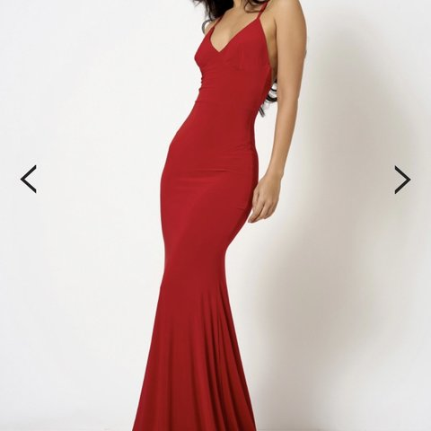 dc3c6a7a0b Selling this red maxi slinky material cross back maxi dress