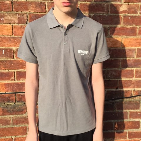 f3b12b85 @gardening67. 2 days ago. Durham, United Kingdom. Moschino Gym, gray polo  shirt. Size Small could fit a medium