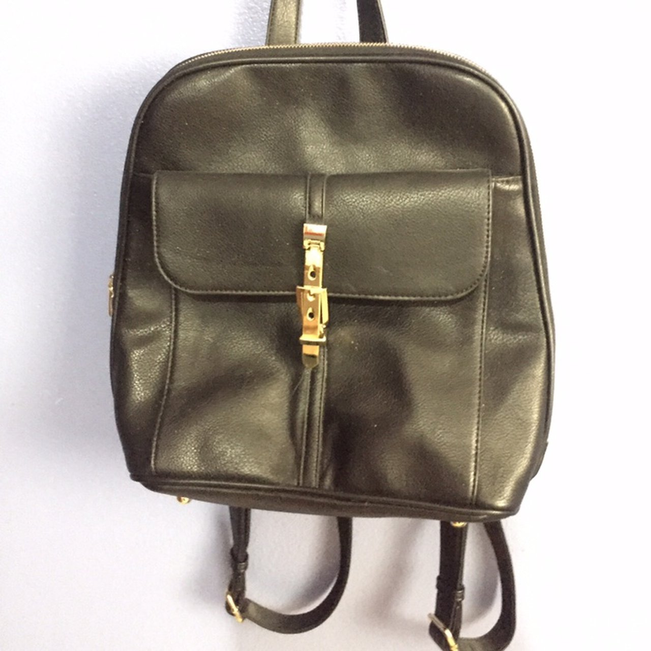 0486a3f5b892 black and gold backpack. barely used