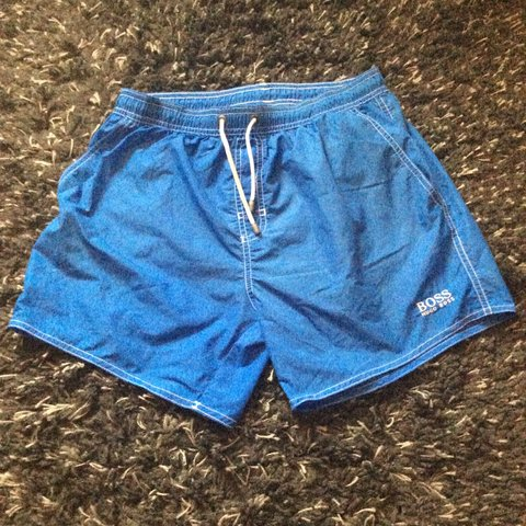 27f164d65 @ashdavies1. 9 months ago. Gloucester, United Kingdom. Men's Hugo boss  light blue swim shorts.