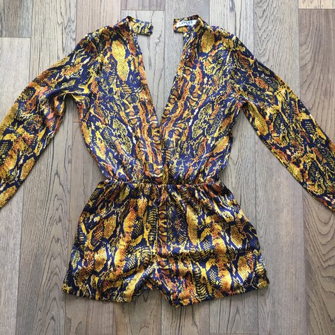 e32c58bd18f Open back snake print playsuit would fit a size - Depop