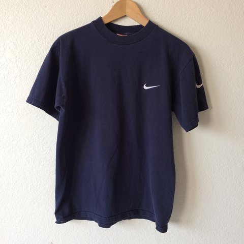 a18c6106 @deanz74. last year. Fontana, United States. Vintage 90s Nike Navy Blue Swoosh  Embroidered Logo Men's Unisex T-Shirt.