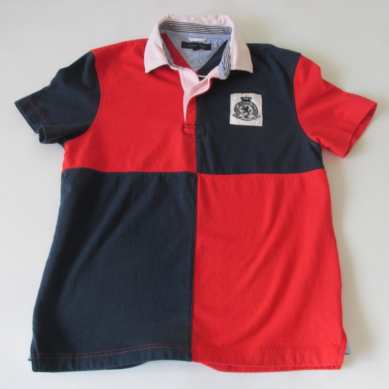 4036c164 @deanz74. 10 months ago. Altadena, United States. Vintage Tommy Hilfiger  Flag Colorway Short Sleeve Rugby Polo Shirt. Authentic. Embroidered logo.