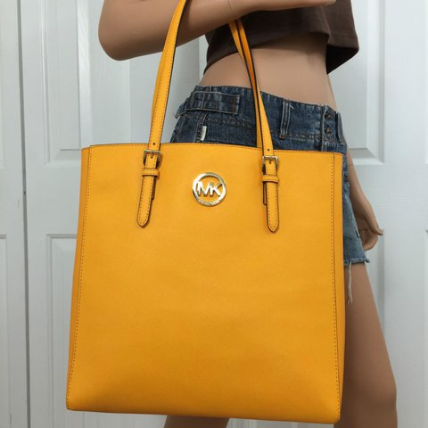 2d4120a40869 @angelacantabile. 2 years ago. Gardena, United States. Michael Kors  saffiano leather jet set travel large tote ...